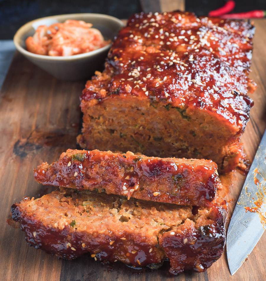 ReKorean meatloaf with gochugang glaze sliced on a cutting board.