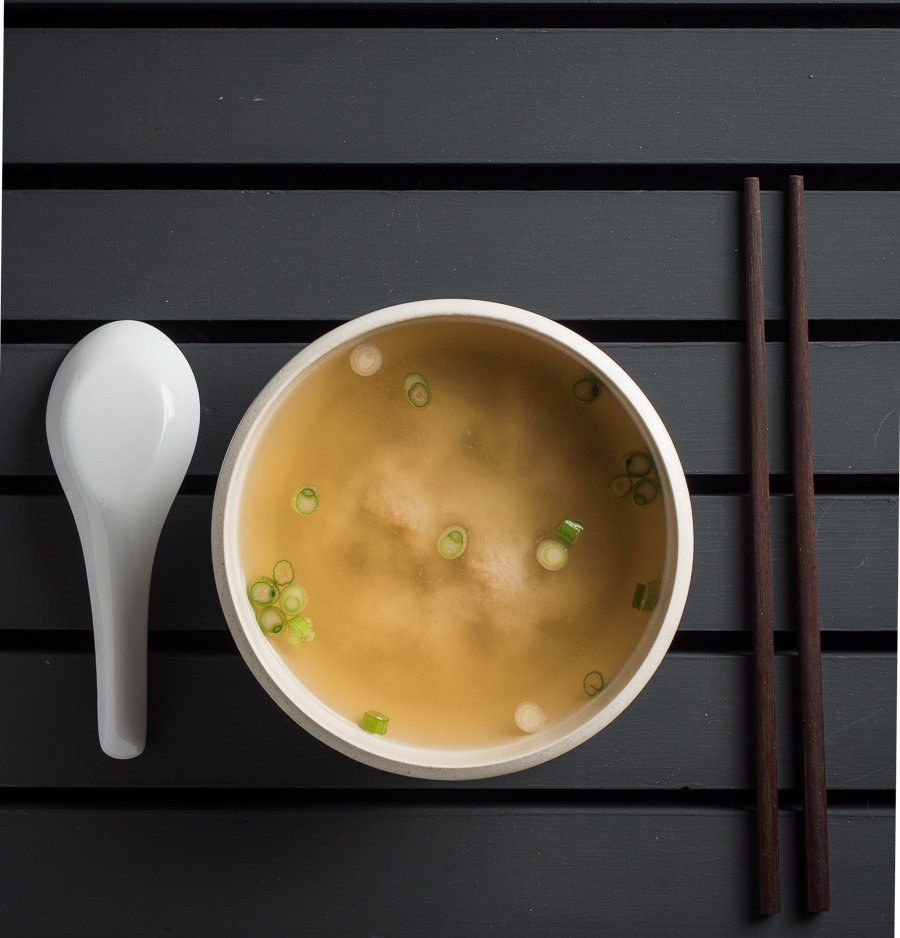 Japanese miso soup in white bowl from above.