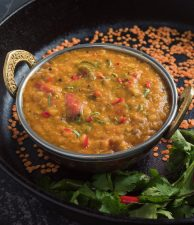 Bengali masoor dal in Indian bowl from the front.