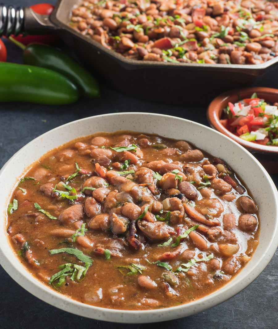Mexican charro beans in a white bowl.