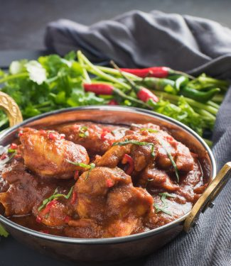 chicken madras in an Indian copper dish