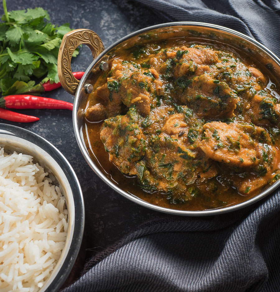 chicken saag curry in an Indian dish