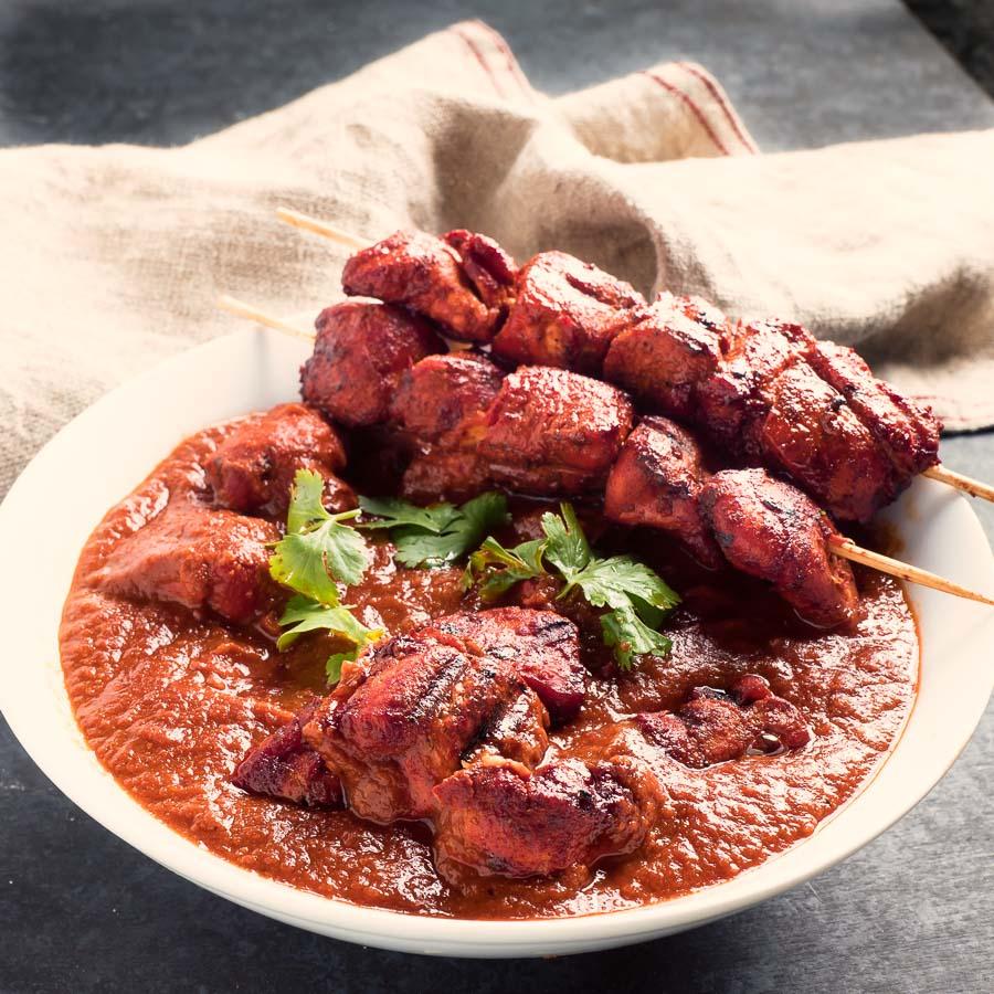 Restaurant style chicken tikka masala with chicken tikka skewers.