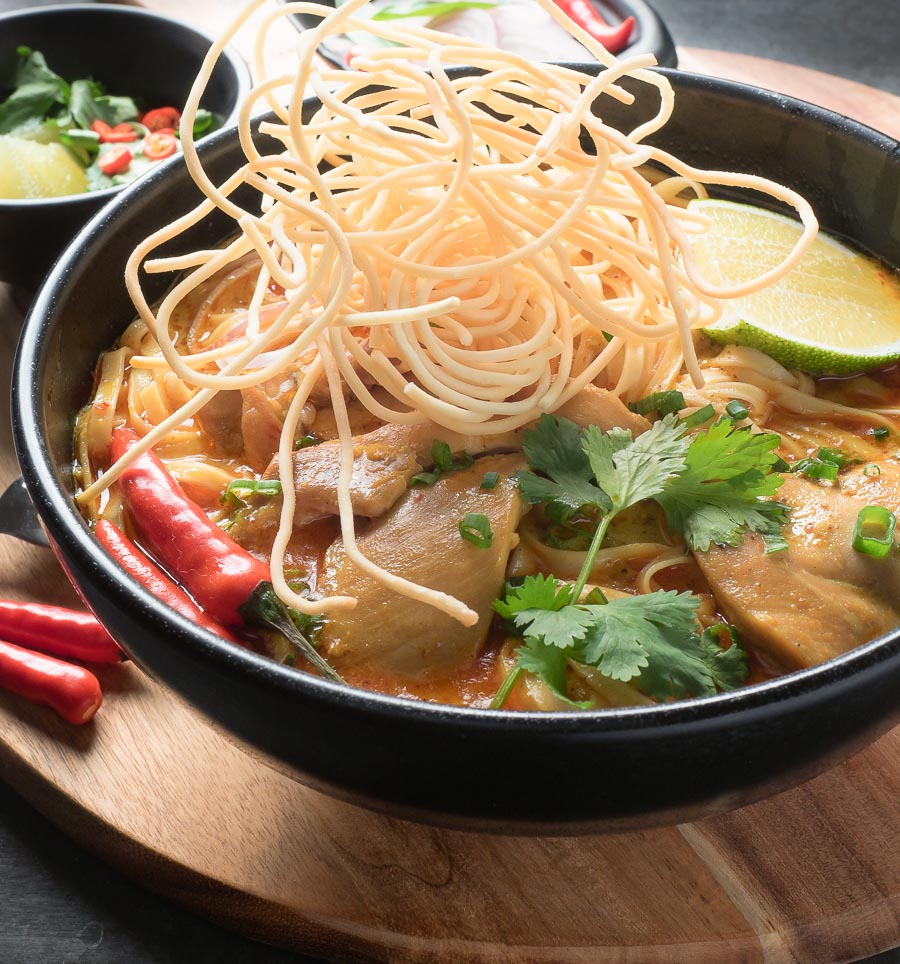 Chicken khao soi with fried noodle garnish.