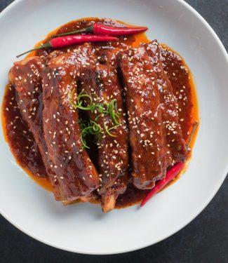 Korean braised pork ribs with sesame seed garnish