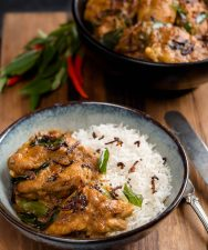 Nadan chicken curry in a bowl with rice.