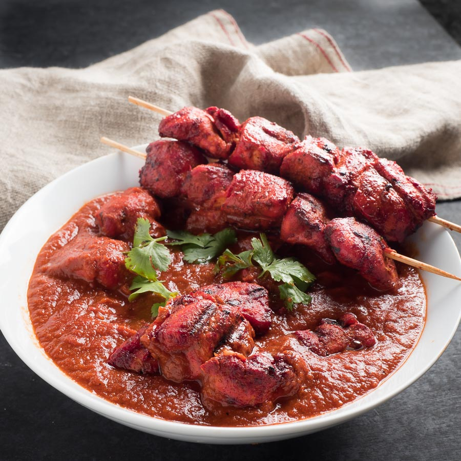 Restaurant style chicken tikka masala with chicken tikka skewers.