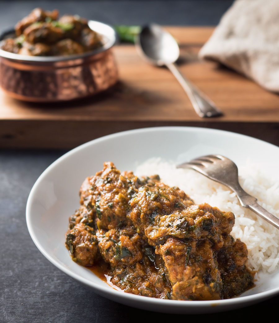 Lamb saag with rice on a plate.