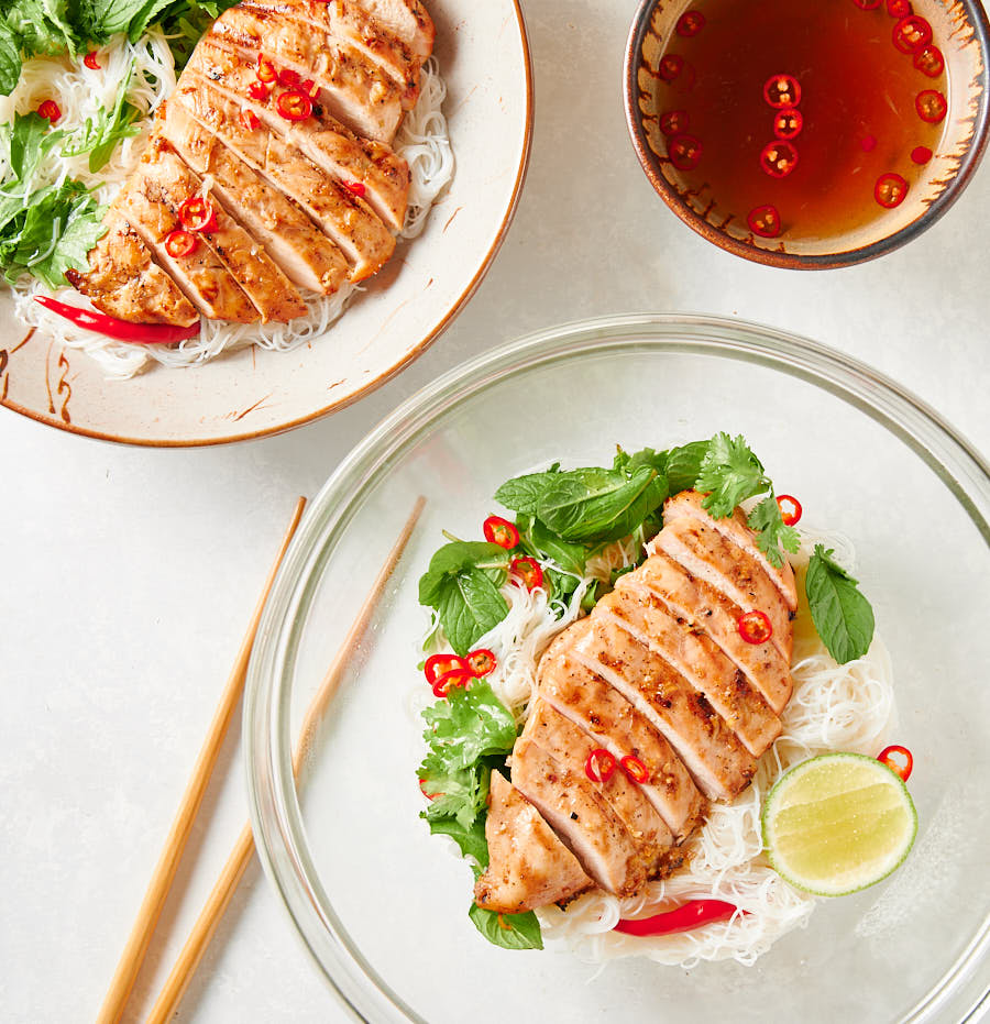 Vietnamese lemongrass chicken in a glass serving bowl from above.