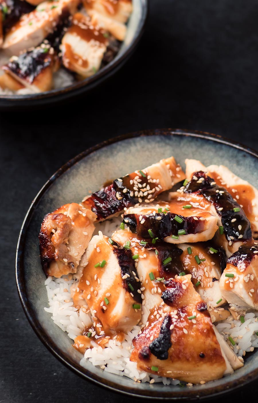 Miso chicken with ginger and maple in a bowl with rice.