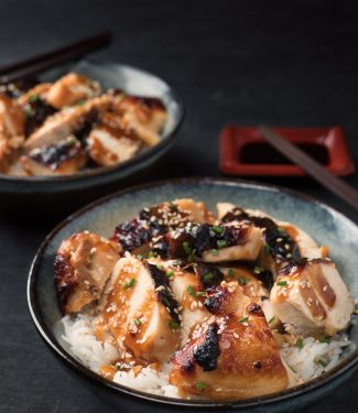 Miso chicken with ginger and maple in a bowl with chopsticks