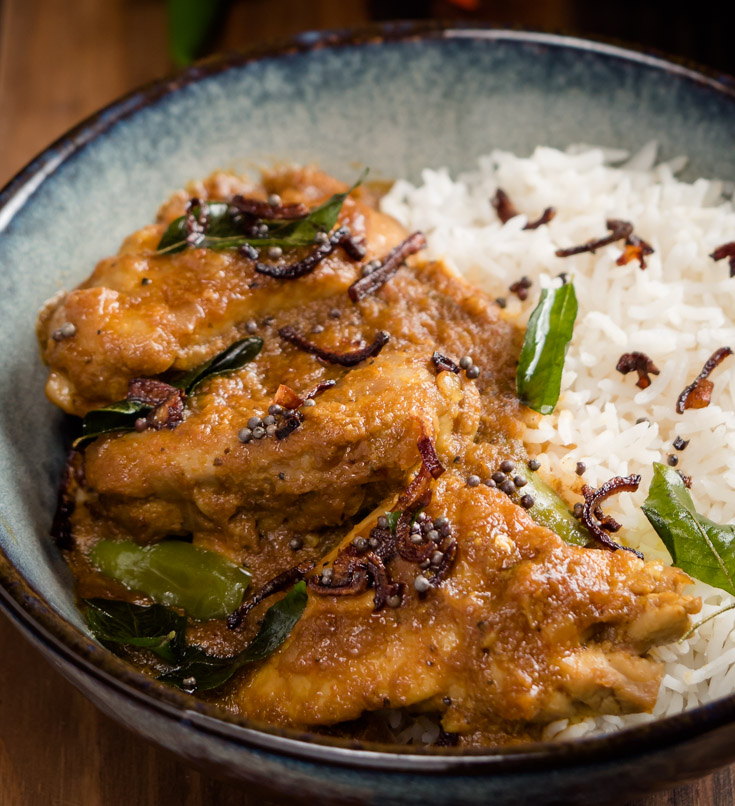 Close-up of nadan chicken curry with rice.