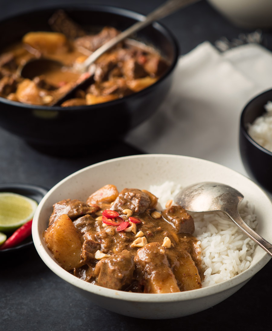 Beef massaman curry with rice and spoon.