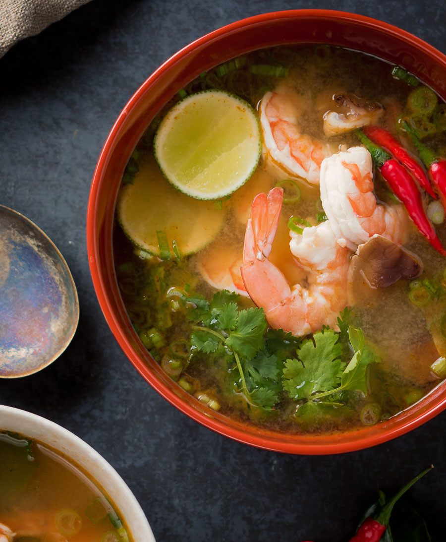 Tom yum soup in a big bowl from above.