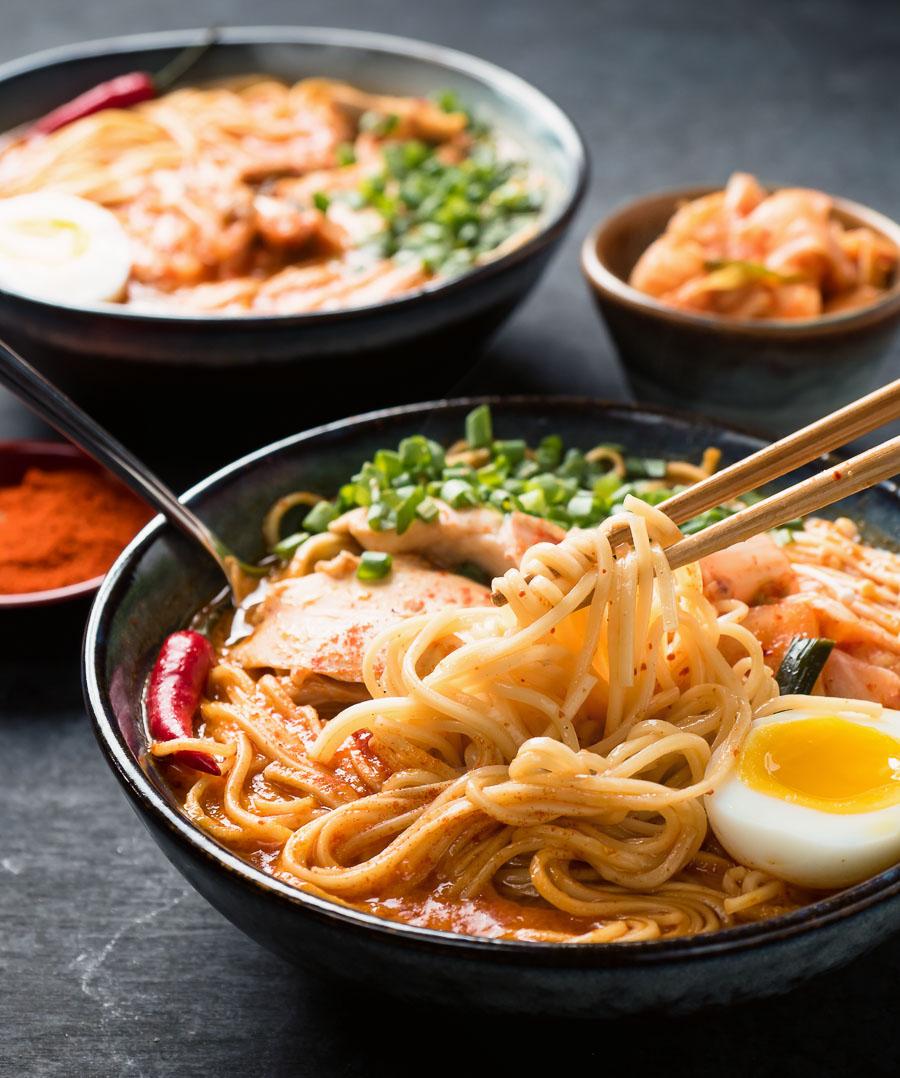 Chopstick full of Korean ramen noodles.