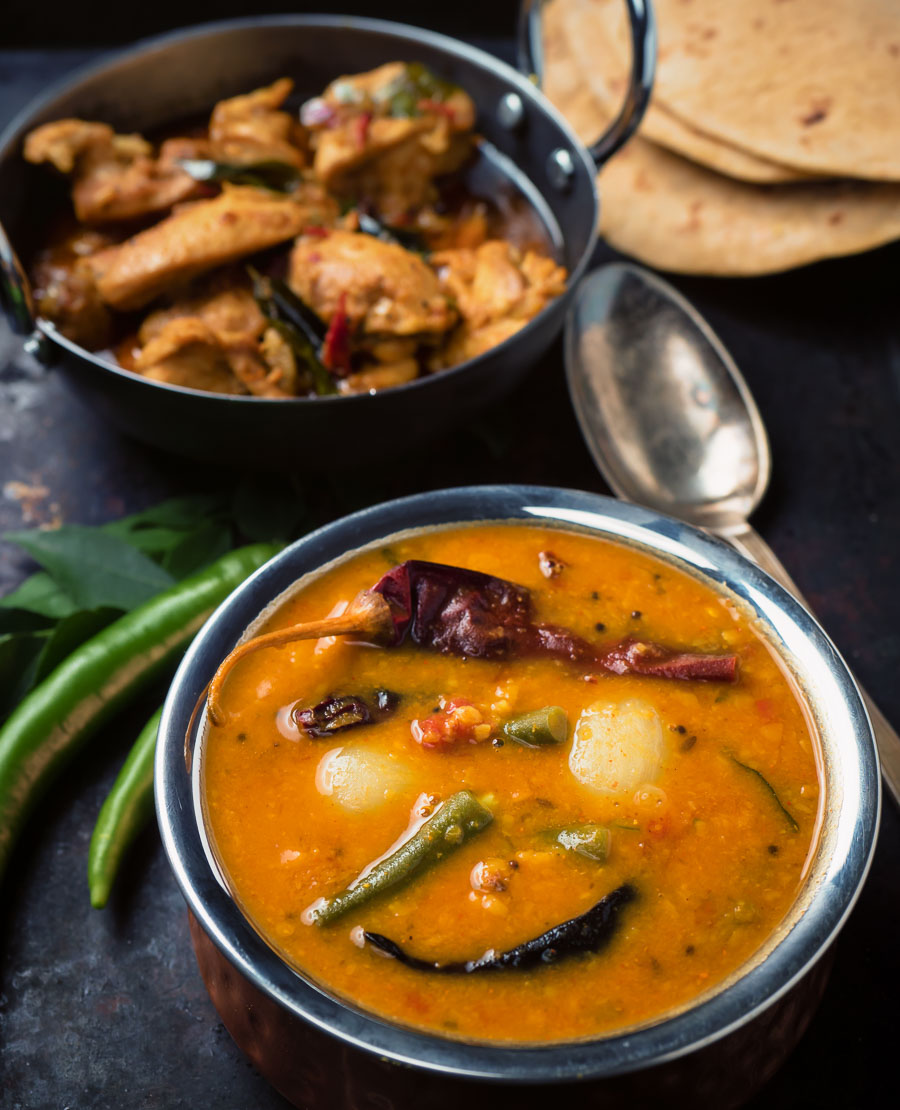 South Indian sambar along side a chicken curry.