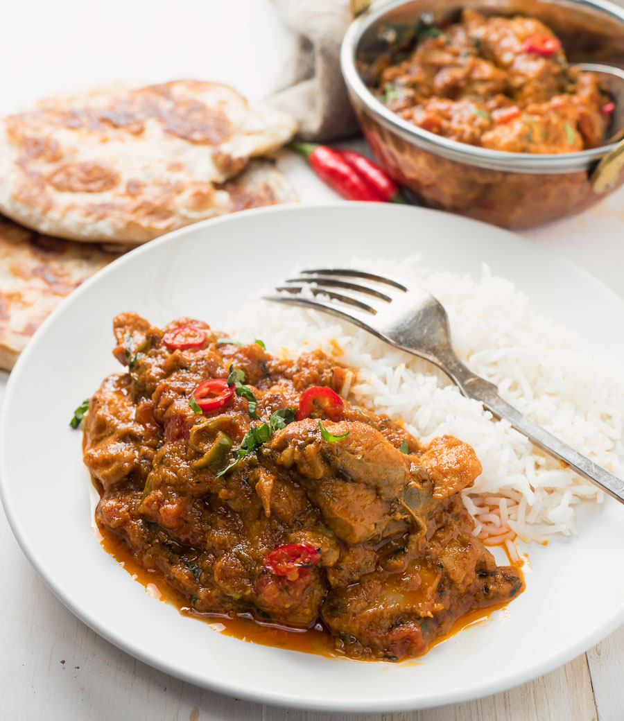 Restaurant karahi chicken curry served with rice.