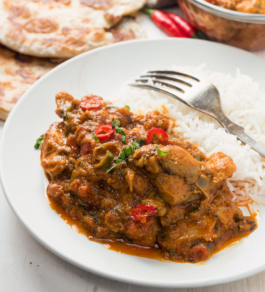 Restaurant karahi chicken on a plate with rice.