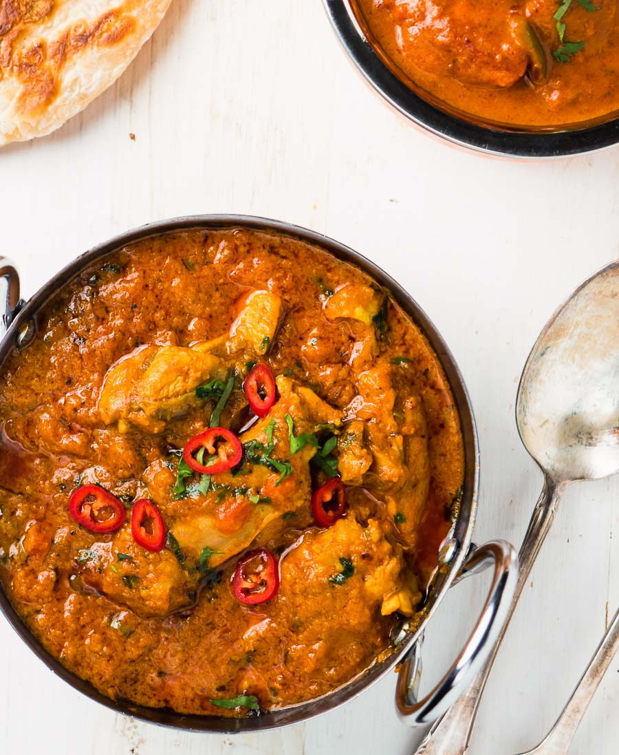 Restaurant karahi chicken curry in a bowl from above.