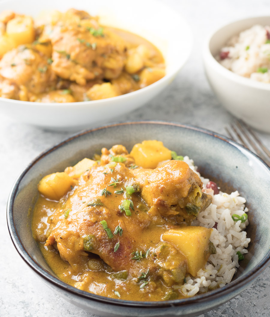Jamaican curry chicken served with rice and peas.