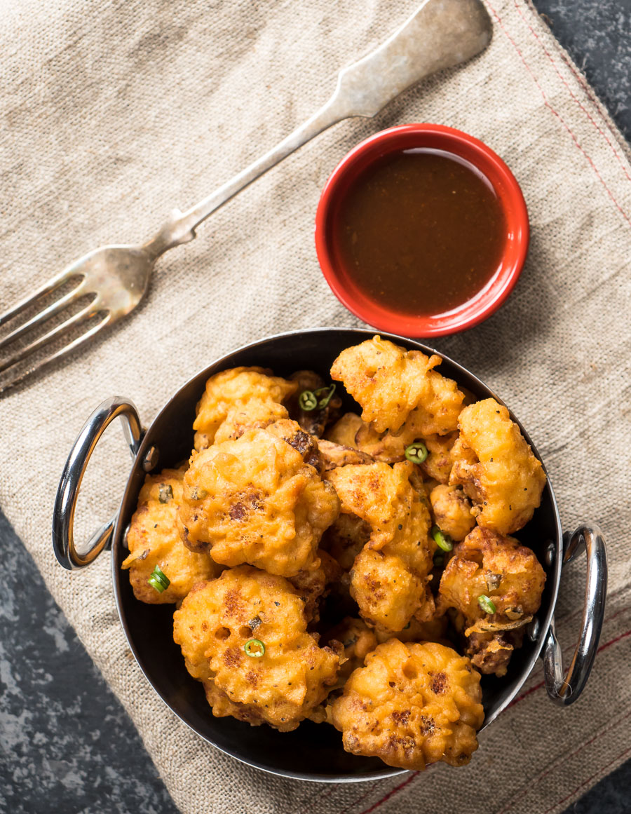 Indian cauliflower wings with spicy tamarind dip.