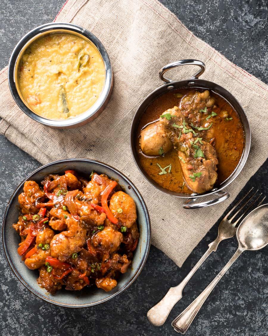 Indian dinner scene featuring gobi manchurian.