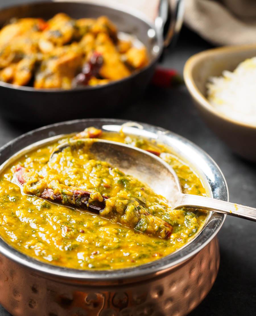 Dal palak close-up in a copper bowl.