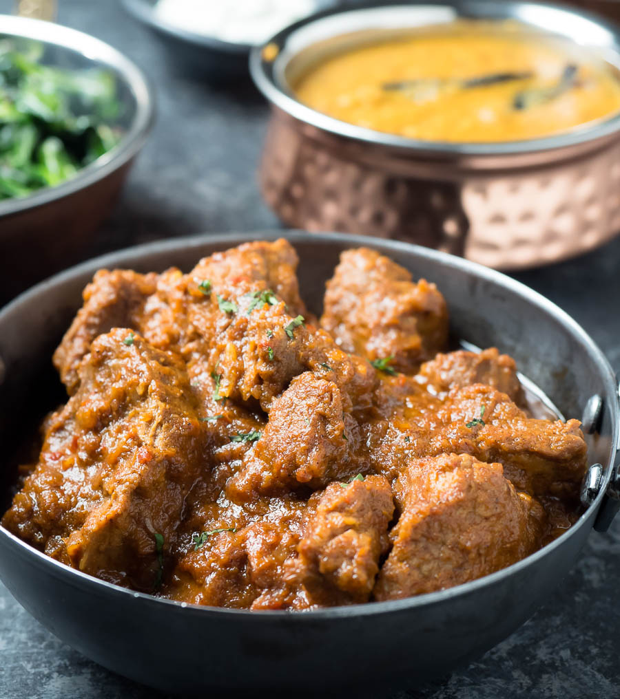 laal maas in a serving bowl