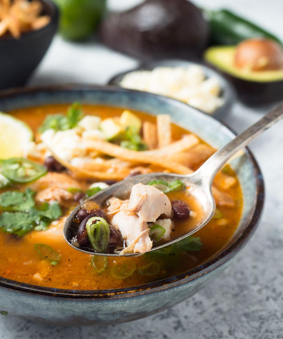 Spoon full of chicken tortilla soup.