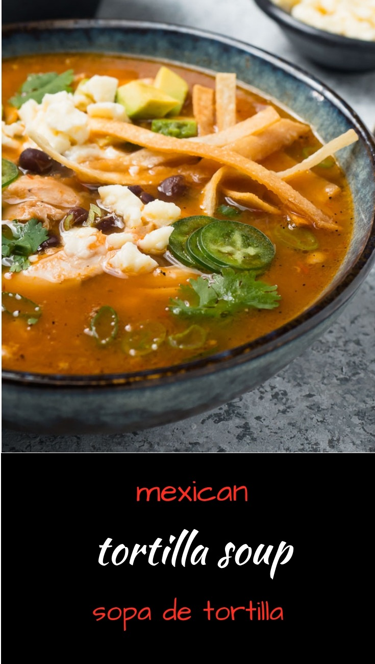 Mexican chicken tortilla soup or sopa de tortilla is a meal in a bowl.