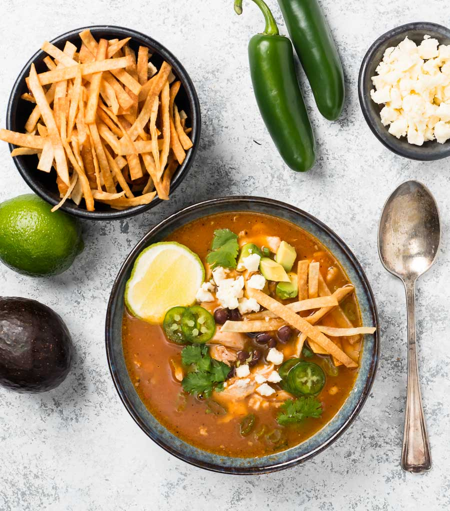 Chicken tortilla soup and garnishes from above.