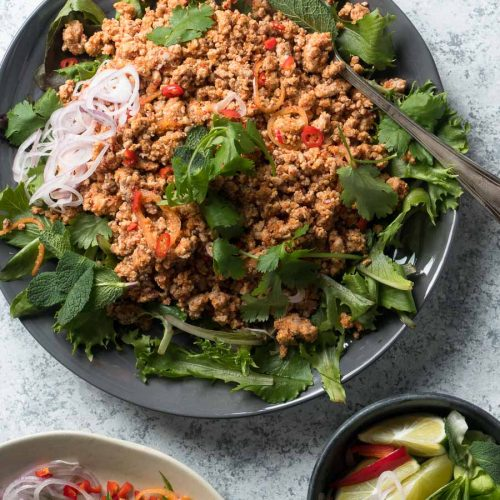 Thai larb salad with greens on a plate from above.
