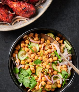 Chana chaat in a serving bowl with spoon from above.