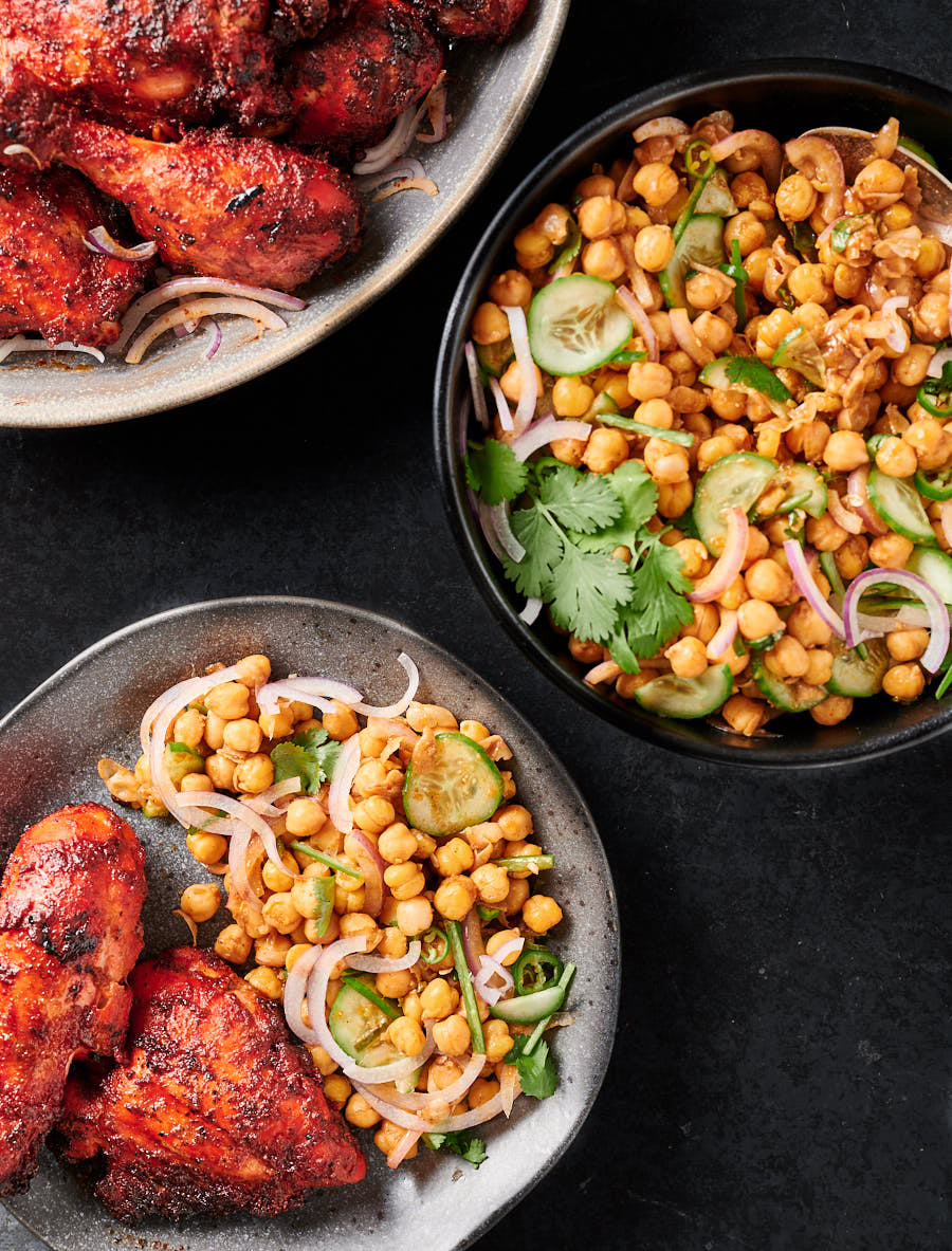 Plate with chana chaat with tandoori chicken from above.