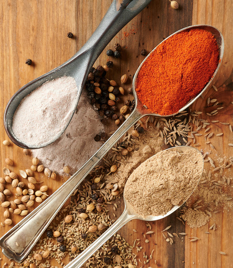Chaat masala ingredients. Spices on spoons.