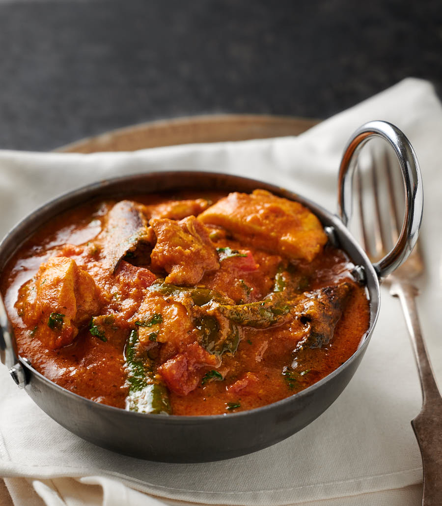 Chicken masala in a bowl from the front.