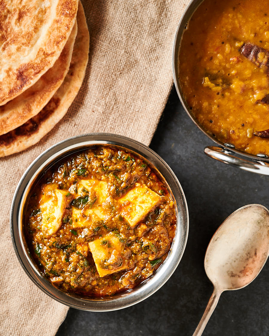Table scene with dal and parathas from above.