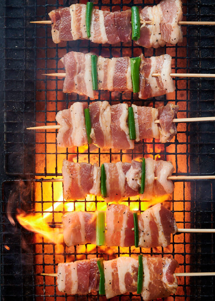 Pork belly skewers on the grill