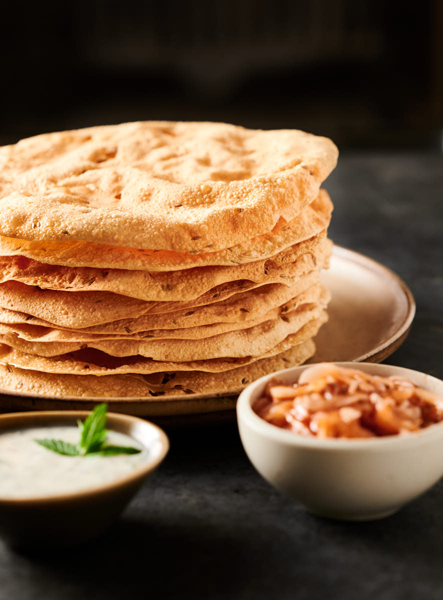 Tall stack of papadum from the front.