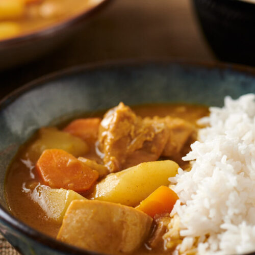 Closeup of Japanese chicken curry in a bowl from the front.