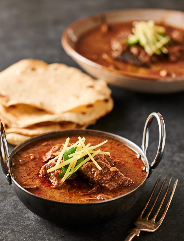 Nihari gosht in an small bowl with chapatis