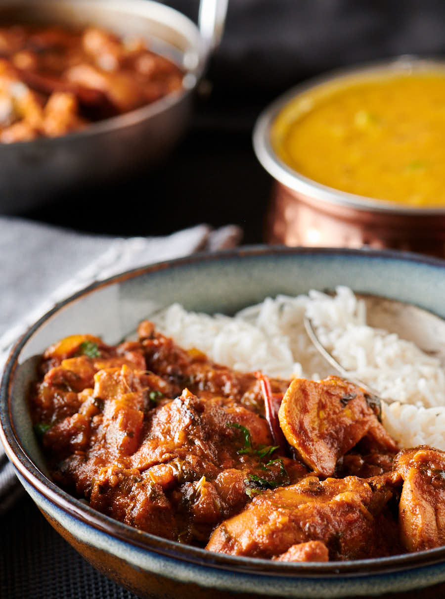 Serving of chicken bhuna and rice from the front.