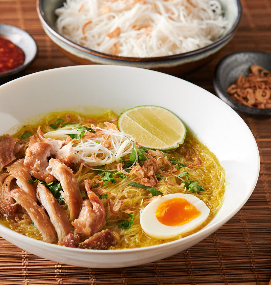 Bowl of soto ayam from the front.
