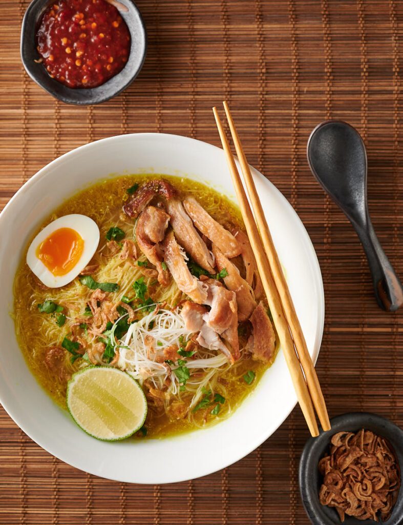Soto ayam bowl with chopsticks from above.
