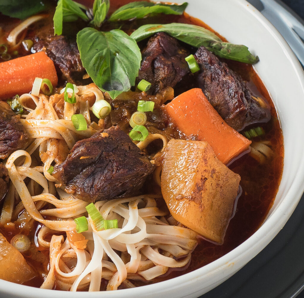 Closeup of a bowl of bo kho from the front.