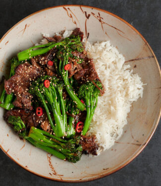 Bowl of Thai beef and broccoli and rice from above.