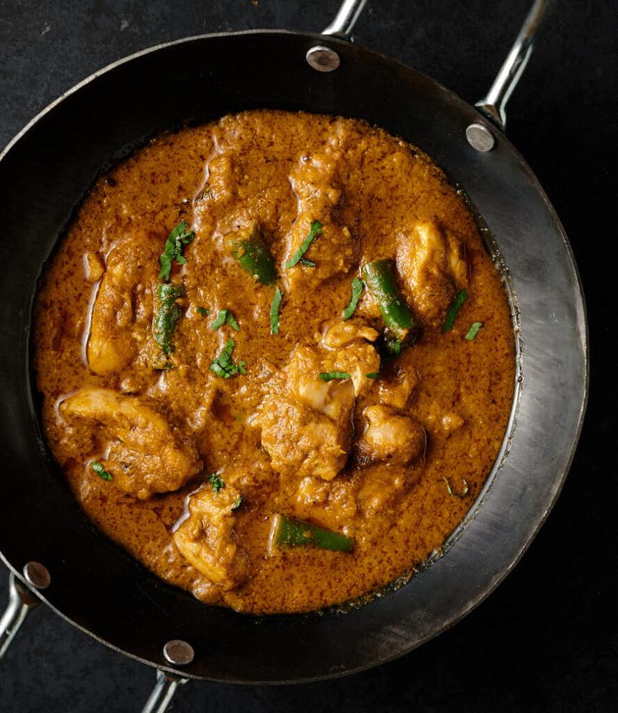 Black karai with hariyali chicken from above.