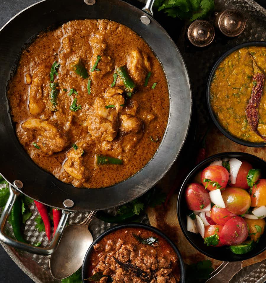 Hariyali chicken in a karai table scene from above
