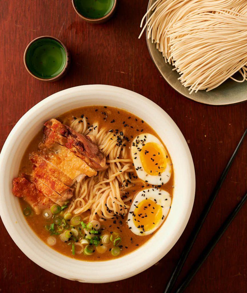 Curry chicken ramen, sake and fresh ramen noodles from above.