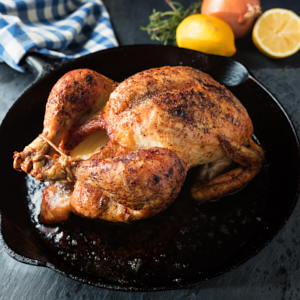 French roast chicken in a cast iron pan.